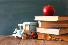 Back to school concept. Blackboard with books Royalty Free Stock Images