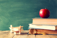 Back to school concept. Blackboard with books and apple Royalty Free Stock Images