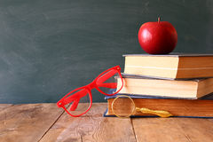 Back to school concept. Blackboard with books Royalty Free Stock Photo