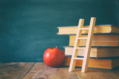 Back to school concept. Blackboard with books Stock Photography