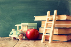 Back to school concept. Blackboard with books Royalty Free Stock Photography