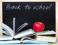 Back to school concept blackboard open books & apple. Royalty Free Stock Images
