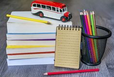Back to School Concept with Books and School Bus stock photography