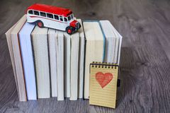 Back to School Concept with Books and School Bus stock image