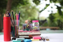 Back to school concept.Books and supplies on white wooden floor royalty free stock photography