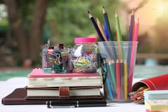 Back to school concept.Books and supplies on white wooden floor stock images