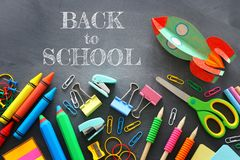 Back to school concept. cardboard rocket and pencils over classroom blackboard. top view, flat lay.  royalty free stock photo