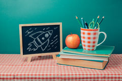 Back to school concept with chalkboard, books and apple Royalty Free Stock Image