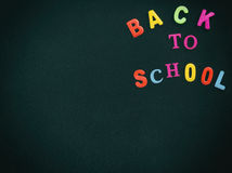 Back to school concept - chalkboard in classroom. Back to school concept - old dark chalkboard in classroom Royalty Free Stock Photo