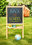 Back to school concept - chalkboard in the garden Royalty Free Stock Photos