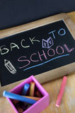 Back to school concept on chalkboard Royalty Free Stock Photo