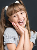 Back to school concept - cheering girl looking at camera Royalty Free Stock Images