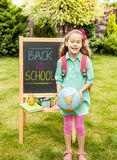 Back to school concept - child girl in front of chalkboard Stock Image