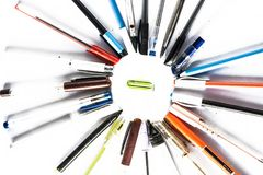 Back to school concept. Close up of crayons assembled in a circular portion and a eraser in centre Concept of get back to school Royalty Free Stock Photos