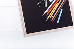 Back to school concept, colored pencils on black table, multicolored stationery accessories for educator teaching kid drawing on stock photos
