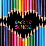 Back to school concept. Colorful pencils arranged as heart on black background. Stock Images