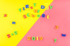 Back to school concept. Creative flat lay back to school concept with welcome letters message on bright yellow and pink paper background with copy space royalty free stock photos