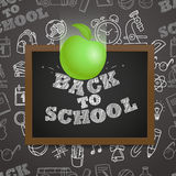 Back to school concept. Falling apple to the letters Stock Photos