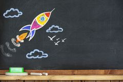 Back to School Concept with Hand Drawn Rocket. On Blackboard Royalty Free Stock Images