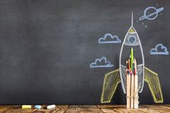 Back to School Concept with Hand Drawn Rocket. On Blackboard Royalty Free Stock Photo