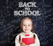 Back to school concept with happy child with school red book. Back to school concept with happy child with school book stock photography