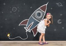 Back to School Concept. Happy Schoolgirl is Ready for Lift Off royalty free stock photo
