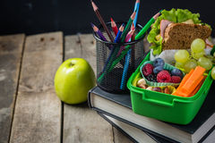 Back to school concept. Healthy lunch and stationary Stock Photos