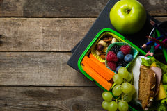 Back to school concept. Healthy lunch and stationary Royalty Free Stock Images