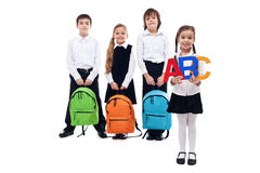 Back to school concept with kids holding schoolbags. Back to school concept with kids holding colorful schoolbags - isolated Stock Photos