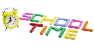 Back to school concept. Letters made of plasticine and alarm clock as concept for school time Stock Photo