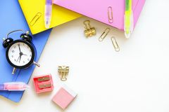 A set of different school supplies, pink, blue and yellow color. Top view, copy space. royalty free stock photography