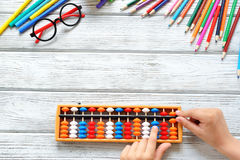 Back to School concept - office and student supplies work desk. Mental arithmetic royalty free stock photo