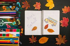 Back to school concept. School and office supplies on blackboard background stock photo