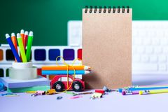 Back to school concept. School and office supplies, colorful pens, pencils, paints on green background. Back to school concept. School and office supplies stock photo