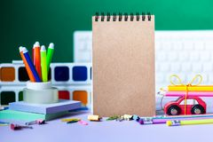 Back to school concept. School and office supplies, colorful pens, pencils, paints on green background. Back to school concept. School and office supplies royalty free stock photography