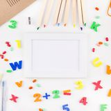 Back to school concept with office supplies. Square flat lay back to school concept with color school and office supplies on white table background with copy royalty free stock photo