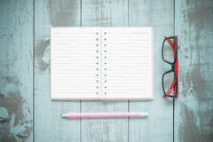 Back to school concept. open book and pencils on wooden backgrou Royalty Free Stock Image