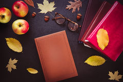 Back to school concept. Open notebook top view on the pile of bo Royalty Free Stock Image