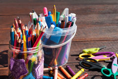 Back to school concept. Pencils, markers, scissors on wooden background Royalty Free Stock Images