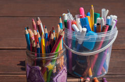 Back to school concept. Pencils, markers, scissors on wooden background Stock Photo