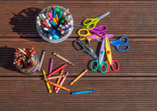 Back to school concept. Pencils, markers, scissors on wooden background Stock Image