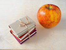 Back to school concept. Pile of small books and red apple. Back to school concept Stock Photography