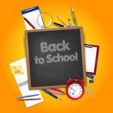 Back to school concept - school accessories and chalkboard Royalty Free Stock Photo