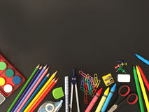School supplies on blackboard background. royalty free stock photography