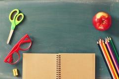 Back to school concept. school supplies on blank blackboard Stock Photo