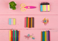 Back to school concept - school supplies: scissors, eraser, markers, crayons and other accessories. On pink wooden table Stock Photography