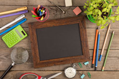 Back to school concept - school supplies on the wooden desk Royalty Free Stock Image