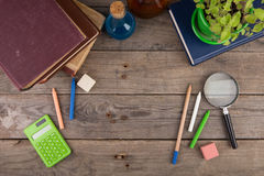 Back to school concept - school supplies on the wooden desk Royalty Free Stock Photos