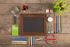 Back to school concept - school supplies on the wooden desk Royalty Free Stock Photography