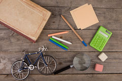 Back to school concept - school supplies on the wooden desk Royalty Free Stock Images